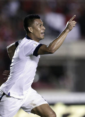 Photo - Michael Orozco of the U.S. celebrates after score a goal against Panama during a 2014 World Cup qualifying soccer match in Panama City, Tuesday, Oct. 15, 2013. (AP Photo/Arnulfo Franco)
