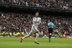Photo - Real Madrid's Sergio Ramos celebrates his goal during a Spanish La Liga soccer match against FC Barcelona at the Santiago Bernabeu stadium in Madrid, Spain, Saturday, March 2, 2013. (AP Photo/Andres Kudacki)