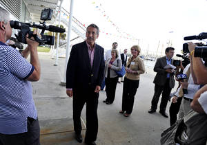 Photo - Former South Carolina Gov. Mark Sanford, center, arrives during a campaign stop at the Charleston Maritime Center on Tuesday, April 30, 2013 in Charleston, S.C. (AP Photo/Rainier Ehrhardt)