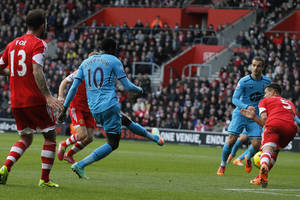 Photo - Tottenham Hotspur's Emmanuel Adebayor, second left, shoots to score against Southampton during their English Premier League soccer match at St Mary's stadium, Southampton, England, Sunday, Dec. 22, 2013. (AP Photo/Sang Tan)