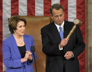 Photo - House Minority Leader Nancy Pelosi of Calif. applauds after handing the gavel to House Speaker John Boehner of Ohio who was re-elected as House Speaker of the 113th Congress, Thursday, Jan. 3, 2013, on Capitol Hill in Washington. (AP Photo/Susan Walsh)