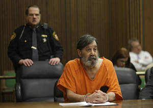 Photo - John Donald Cody speaks during his sentencing on racketeering, theft, money laundering charges Monday, Dec. 16, 2013, in Cleveland. Cody, using the stolen identity Bobby Thompson, was sentenced to 28 years in prison for defrauding donors of up to $100 million in 41 states through the United States Navy Veterans Association, a charity he ran in Tampa, Fla. (AP Photo/Mark Duncan)