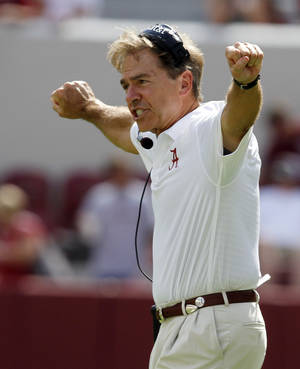 Photo - Alabama head coach Nick Saban signals to his a players during the second half of an NCAA college football game against Georgia State on Saturday, Oct. 5, 2013, in Tuscaloosa, Ala. (AP Photo/Butch Dill)