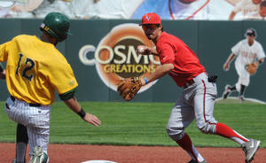 Photo - UNLV shortstop Matt McCallister throws to first for a double play after putting out North Dakota State's Andy Wicklund during an NCAA college baseball tournament regional game in Corvallis, Ore., Saturday, May 31, 2014. (AP Photo/Mark Ylen)