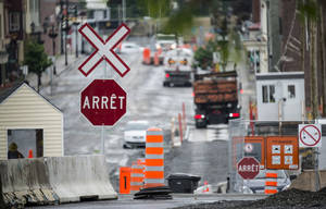 Photo - The downtown of Lac-Megantic, Quebec, remains closed June 10, 2014, as crews work at the clearing and decontamination a year after an oil-filled train screeched off the tracks and exploded killing 47 people. (AP Photo/The Canadian Press, Paul Chiasson)