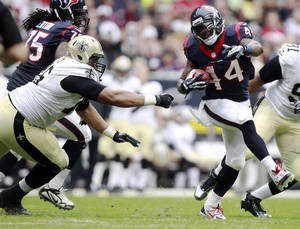 Photo - Houston Texans running back Ben Tate (44) maneuvers past New Orleans Saints defensive tackle Akiem Hicks (76) during the first half of a preseason NFL football game, Sunday, Aug. 25, 2013, in Houston. (AP Photo/Patric Schneider)