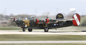 Photo - A B-24J Liberator lands Friday at Wiley Post Airport in Bethany.