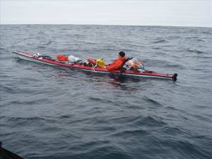 """Photo - This Tuesday, June 10, 2014 image provided by the U.S. Coast Guard shows the moments before a rescue of a kayaker about 60 miles southwest of Santa Barbara's Point Conception near southern California. The U.S. Coast Guard says a man is """"lucky to be alive"""" after he was rescued 11 days into an attempted kayak voyage from California to Hawaii. A helicopter spotted the 57-year-old man, who had turned back to California after he sent a distress call indicating equipment failure, the Coast Guard said in a statement.  (AP photo/U.S. Coasst Guard)"""