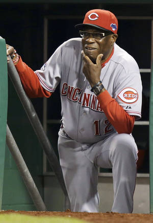 Photo - Cincinnati Reds manager Dusty Baker watches from the dugout steps as the Pittsburgh Pirates bat in the fifth inning of the NL wild-card playoff baseball game Tuesday, Oct. 1, 2013, in Pittsburgh. (AP Photo/Gene J. Puskar)