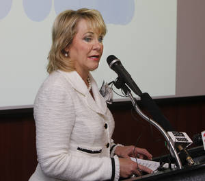 Photo - Gov. Mary Fallin discusses a new series of jobs being offered Thursday by AT&T during a news conference at the Oklahoma City Chamber of Commerce in Oklahoma City. Photo by Paul Hellstern, The Oklahoman <strong>PAUL HELLSTERN</strong>