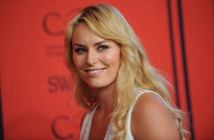"Photo - FILE - This June 3, 2013 file photo shows alpine ski racer Lindsey Vonn at the 2013 CFDA Fashion Awards in New York. Vonn will be working for NBC during the Winter Olympics, although she won't be traveling to Sochi. The network said Monday, Jan. 27, 2014, that the gold medalist will report on the Olympics for the ""Today"" show and some NBC Sports broadcasts. Vonn was expected to defend her championship at the Olympics, which begin next week. But a leg injury has kept her out of the competition, and is preventing her from going to Russia. (Photo by Brad Barket/Invision/AP, File)"