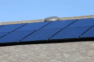 photo - Rooftop solar panels are seen from the backyard of a home at 11424 NW 131 built by Ideal Homes in the Buffalo Grove section of the Village Verde addition northwest of Northwest Expressway and Mustang Road.  Photos by PAUL B. SOUTHERLAND, The Oklahoman