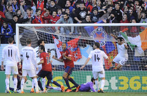 Photo - Osasuna's Jordan Loties, center left,  celebrates after his team scored the second goal against Real Madrid, during their Spanish League soccer match, at El Sadar stadium, in Pamplona northern Spain on Saturday, Dec. 14, 2013. (AP Photo/Alvaro Barrientos)