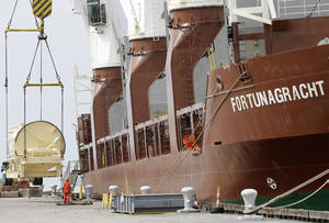 Photo - The Amsterdam-based Fortunagracht, docked at the Port of Cleveland in Ohio, is loaded with road equipment for building highways.    AP Photo <strong>Tony Dejak -  AP </strong>