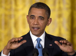 Photo - President Barack Obama speaks during his final news conference of his first term in the East Room of the White House in Washington, Monday, Jan. 14, 2013. (AP Photo/Carolyn Kaster)