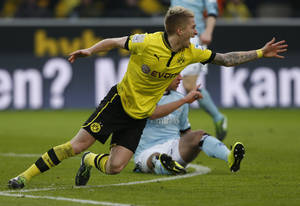 photo - Dortmund's Marco Reus reacts during the German first division Bundesliga soccer match between BvB Borussia Dortmund  and Hamburg SV in Dortmund, Germany, Saturday, Feb. 9, 2013. (AP Photo/Frank Augstein)