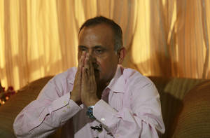 Photo - Uttam Khobragade, father of Indian diplomat Devyani Khobragade who was arrested and strip-searched in New York, gestures as he speaks at a press conference in Mumbai, India, Thursday, Dec. 19, 2013. The case has sparked a diplomatic furor between the United States and India, which is incensed over what its officials describe as degrading treatment of India's deputy consul general in New York. (AP Photo/Rafiq Maqbool)