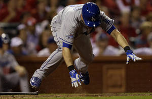 Photo - Los Angeles Dodgers' Michael Young trips as he grounds into a double play during the 12th inning of Game 1 of the National League baseball championship series against the St. Louis Cardinals Friday, Oct. 11, 2013, in St. Louis. (AP Photo/Jeff Roberson)