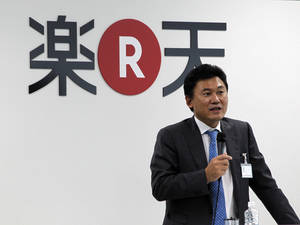 Photo - FILE  - In this Oct. 3, 2011 photo, Rakuten Inc.,Chief Executive Hiroshi Mikitani gives a pep talk in English, the standard language at Rakuten, at a welcoming ceremony for new hires at its headquarters in Tokyo. Rakuten is buying Cyprus-based Viber Media, which operates a popular Internet phone application, for $900 million, fortifying the online retailer's social networking footprint. (AP Photo/Koji Sasahara, File)