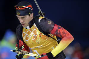 Photo - Germany's Arnd Peiffer leaves the shooting range during the men's biathlon 4x7.5K relay at the 2014 Winter Olympics, Saturday, Feb. 22, 2014, in Krasnaya Polyana, Russia. (AP Photo/Lee Jin-man)