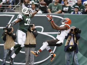 Photo - New York Jets cornerback Antonio Cromartie (31) deflects a pass to Cleveland Browns' Greg Little (18) in the end zone during the first half of an NFL football game on Sunday, Dec. 22, 2013, in East Rutherford, N.J.  (AP Photo/Kathy Willens)
