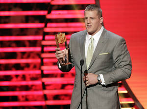 photo - J.J. Watt of the Houston Texans accepts the AP Defensive Player of the Year award at the 2nd Annual NFL Honors on Saturday, Feb. 2, 2013 in New Orleans. (Photo by AJ Mast/Invision/AP)