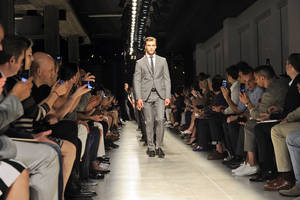 Photo - Models on parade at the end of the Bottega Veneta men's Spring-Summer 2014 collection, part of the Milan Fashion Week, unveiled in Milan, Italy, Sunday, June 23, 2013.  (AP Photo/Giuseppe Aresu)
