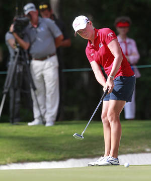 Photo -   Stacey Lewis putts on the 18th green during the third round of the Mobile Bay LPGA Classic golf tournament, Saturday, April 28, 2012, in Mobile, Ala. (AP Photo/Press-Register, Bill Starling) MAGS OUT