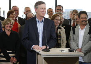 Photo - Colo. Gov. John Hickenlooper, center, takes questions after speaking on oil and gas drilling at the Metro Denver Chamber of Commerce, Thursday, July 17, 2014. Hickenlooper spoke about his opposition to proposed Colorado ballot measures to limit hydrocarbon extraction. The oil and gas industry says those measures would ban drilling, though supporters of the ballot measures disagree. (AP Photo/Brennan Linsley)