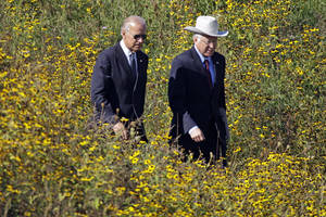 Photo -   Vice President Joe Biden, left, and Interior Secretary Ken Salazar arrive at the Flight 93 National Memorial in Shanksville, Pa., for a memorial service, Tuesday, Sept. 11, 2012. (AP Photo/Gene J. Puskar)