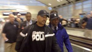 photo -   Detroit Police Chief Ralph Godbee arrived at Detroit Metro Airport in Romulus, Mich., on Wednesday, Oct. 3, 2012 from a flight from San Diego. Godbee was greeted at the gate with a throng of reporters. Detroit Mayor Dave Bing suspended Police Godbee after a subordinate, a 37-year-old internal affairs officer, claimed the two had engaged in a sexual relationship for about a year. (AP Photo/Detroit Free Press, Tammy Stables Battaglia)