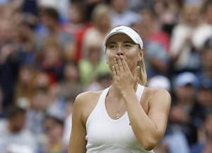 Photo - Maria Sharapova of Russia celebrates defeating Alison Riske of U.S. in their women's singles match at the All England Lawn Tennis Championships in Wimbledon, London, Saturday, June 28, 2014. (AP Photo/Ben Curtis)