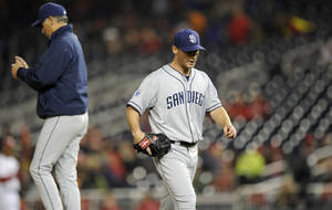 Photo - San Diego Padres starting pitcher Robbie Erlin, right, walks back to the dugout after he was pulled from the game during the sixth inning of a baseball game against the Washington Nationals, Friday, April 25, 2014, in Washington. The Nationals won 11-1. (AP Photo/Nick Wass)