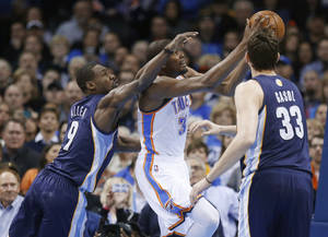Photo - Oklahoma City Thunder forward Kevin Durant (35) is fouled by Memphis Grizzlies guard Tony Allen (9) as he shoots in front of center Marc Gasol during the first quarter of an NBA basketball game in Oklahoma City, Thursday, Jan. 31, 2013. (AP Photo/Sue Ogrocki)
