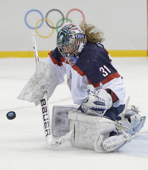 Photo - USA Goalkeeper Jessie Vetter blocks a shot on the goal during the second period of the 2014 Winter Olympics women's ice hockey game against Canada at Shayba Arena, Wednesday, Feb. 12, 2014, in Sochi, Russia. (AP Photo/Matt Slocum)