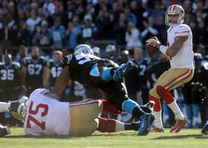 Photo - San Francisco 49ers Colin Kaepernick, right, looks to pass during a divisional playoff NFL football game against the Carolina Panthers, Sunday, Jan. 12, 2014, in Charlotte, N.C. (AP Photo/The Star, Ben Earp)