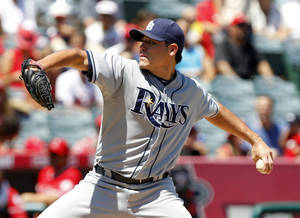 photo -   Tampa Bay Rays starting pitcher Matt Moore delivers against the Los Angeles Angels during the first inning of a baseball game in Anaheim, Calif., Sunday, Aug. 19, 2012. (AP Photo/Alex Gallardo)