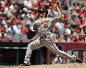 photo -   Baltimore Orioles starting pitcher Wei-Yin Chen, of Taiwan, throws to the Los Angeles Angels during the first inning of a baseball game in Anaheim, Calif., Sunday, July 8, 2012. (AP Photo/Chris Carlson)