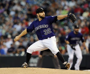 Photo - Colorado Rockies starting pitcher Tyler Chatwood throws in the first inning of a baseball game against the Boston Red Sox on Tuesday, Sept. 24, 2013 in Denver. (AP Photo/Chris Schneider)