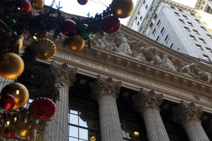 photo - The facade of the New York Stock Exchange is framed by the NYSE holiday tree, Thursday, Dec. 20, 2012. Shares in the company that runs the New York Stock Exchange are surging amid reports that it is in talks to sell itself to a rival stock exchange, Atlanta-based IntercontinentalExchange Inc. (AP Photo/Richard Drew)