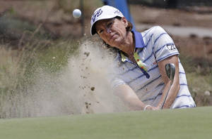 Photo - Juli Inkster chips to the 10th green during a practice round for the U.S. Women's Open golf tournament in Pinehurst, N.C., Wednesday, June 18, 2014. (AP Photo/Bob Leverone)