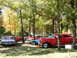 Photo - Above: Classic cars line up for display at the Robbers Cave Fall Festival.