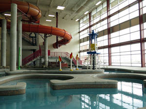Photo - In this March 27, 2014 photo an oil derrickand the flames of gas fires decorate an indoor water park at a new recreation center in oil-rich Williston, North Dakota. The city hopes the center will help draw families to North Dakota's oil patch. (AP Photo/Josh Wood)