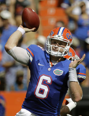 Photo -   Florida quarterback Jeff Driskel throws a pass during the first half of an NCAA college football game Saturday, Sept. 1, 2012, in Gainesville, Fla. (AP Photo/John Raoux)