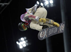 Photo - Shaun White of the United States gets air during a snowboard half pipe training session at the Rosa Khutor Extreme Park at the 2014 Winter Olympics, Monday, Feb. 10, 2014, in Krasnaya Polyana, Russia.  (AP Photo/Sergei Grits)