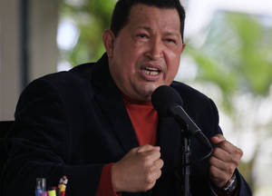 Photo -   Venezuela's President Hugo Chavez speaks during a news conference in Caracas, Venezuela, Wednesday, Sept. 5, 2012. (AP Photo/Fernando Llano)