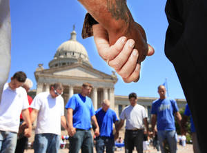 Photo - A group of men from Gallian Masonry invited other men to join in a circle of prayer in 2010 before the start of official ceremony.   Nearly 300 people gathered in 2010 on the south plaza of the state Capitol to observe National Day of Prayer.   Photo by Jim Beckel, The Oklahoman Archive <strong>JIM BECKEL - THE OKLAHOMAN</strong>