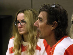 photo -   Paul and Sheila Comer appear in court during a hearing in Dallas, Ga., Thursday, Oct. 4, 2012. The Comers are accused of locking their teenaged son in a bedroom with little food for years. The Comers were arrested last month and accused of abusing 18-year-old Mitch Comer. He weighed 87 pounds when he was found in Los Angeles. (AP (AP Photo/John Bazemore)