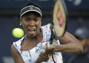 Photo - Venus Williams of the U.S. returns the ball to Ana Ivanovic of Serbia during the third day of Dubai Duty Free Tennis Championships in Dubai, United Arab Emirates, Wednesday, Feb. 19, 2014. (AP Photo/Kamran Jebreili)
