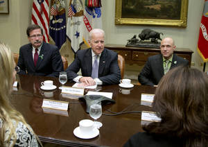 Photo - Vice President Joe Biden meets with Newtown shooting family members, including Bill Sherlach, widower of school psychologist Mary Sherlach, left, and Jeremy Richman, father of Avielle Richman, right, during a photo opportunity before a meeting in the Roosevelt Room of the White House in Washington, Tuesday, Dec. 10, 2013, about the administration's efforts to increase access to mental health services. (AP Photo/Carolyn Kaster)
